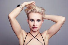 Fashion young gay.Transvestite. Fashion young gay.blonde Transvestite.boy looks like a girl Royalty Free Stock Images