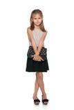 Fashion young girl with a handbag Royalty Free Stock Photography
