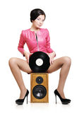Fashion young girl with vinyl and speaker Royalty Free Stock Photography