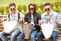 Fashion young guys go shopping Stock Image