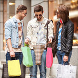 Fashion young guys go shopping Stock Image