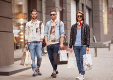 Fashion young guys go shopping Stock Images