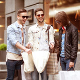 Fashion young guys go shopping Royalty Free Stock Images