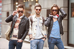 Fashion young guys go shopping Royalty Free Stock Photo