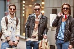 Fashion young guys go shopping stock photos