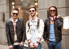 Fashion young guys go shopping Royalty Free Stock Image