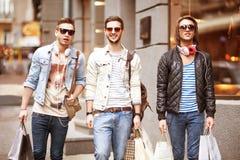 Fashion young guys go shopping Stock Photo