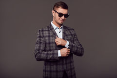 Fashion young handsome man with fashionable sunglasses Royalty Free Stock Photography