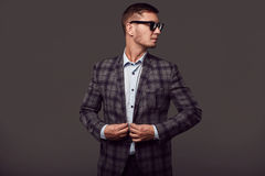 Fashion young handsome man with fashionable sunglasses Stock Image