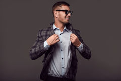 Fashion young handsome man with fashionable sunglasses Royalty Free Stock Photos