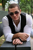 Fashion young man. This picture represents a fashion young man wearing sun glasses Stock Images