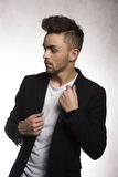 Fashion young man in black Stock Photos