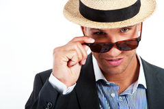Fashion young man holding his fashionable sunglasses Stock Photos
