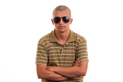 Fashion young man holding sunglasses Royalty Free Stock Images