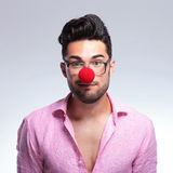 Fashion young man with a red nose Royalty Free Stock Photos