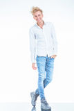 Fashion young man standing on isolated background while Stock Images