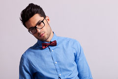Fashion young man wearing glasses and bow tie Royalty Free Stock Photos