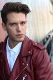 Fashion young model man portrait. Handsome Guy. Vogue style image of elegant young man. Hairstyle Royalty Free Stock Photos