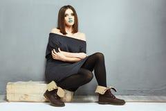 Fashion young model pose. Studio. Full body Royalty Free Stock Image