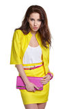 Fashion young model in yellow style Royalty Free Stock Image