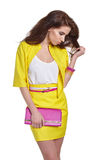 Fashion young model in yellow style Royalty Free Stock Photo