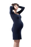 Fashion young pregnant girl. In blue dress Royalty Free Stock Photo