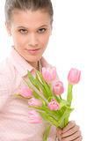 Fashion - young romantic woman with spring tulips stock photography