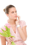 Fashion - young romantic woman with spring tulips Royalty Free Stock Images