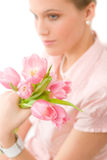 Fashion - young romantic woman with spring tulips Stock Photo