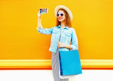 Fashion young smiling woman takes a picture self portrait on the smartphone Royalty Free Stock Photos