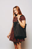 Fashion young woman with bag. Royalty Free Stock Photo