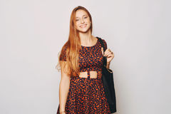 Fashion young woman with bag. Royalty Free Stock Images
