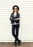 Fashion young woman in black rock style over white Stock Photos