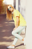 Fashion young woman in the city, stylish model posing Royalty Free Stock Images