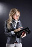 Fashion young woman with clutch Royalty Free Stock Photography
