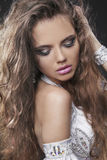 Fashion young woman with curly hair Royalty Free Stock Image