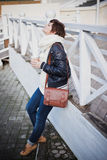 Fashion young woman drinking coffee on the street Royalty Free Stock Image