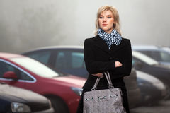Fashion young woman in a foggy morning Royalty Free Stock Images