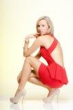Fashion young woman in full length posing. Studio shot. Stock Photo