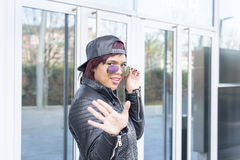 Fashion young woman greeting hello. Royalty Free Stock Images