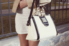 Fashion young woman with handbag and white skirt Royalty Free Stock Photo