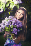 Fashion young woman with lilac flowers Royalty Free Stock Photo