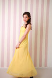 Fashion young woman in long yellow dress Stock Photography