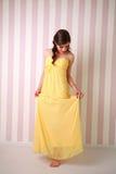 Fashion young woman in long yellow dress Stock Image