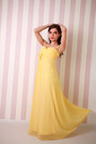 Fashion young woman in long yellow dress Royalty Free Stock Photo