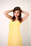 Fashion young woman in long yellow dress, studio Royalty Free Stock Photos