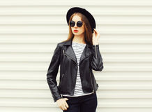 Fashion young woman model in black rock style stands over white Royalty Free Stock Image