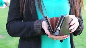 Fashion young woman open black purse clutch in. Hand UHD footage stock footage