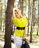 Fashion young woman in a pine forest, portrait girl outdoors Royalty Free Stock Images