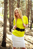 Fashion young woman in a pine forest, portrait girl outdoors Royalty Free Stock Image